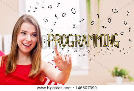 Programming concept with young woman in her home