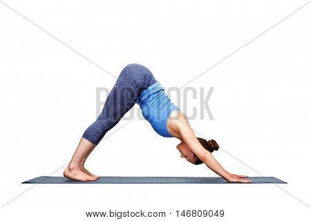 Beautiful sporty fit yogini woman practices yoga asana adhomukha svanasana - downward facing dog pose in studio isolated on white