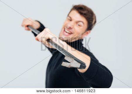Closeup of man criminal thief standing and using crowbar