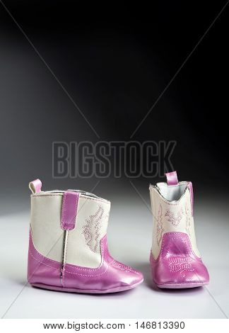 Pink baby boots with room for your type.