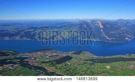 View from Mt Niesen popular travel destination in the Swiss Alps. Spiez town at lake Thunersee. Mt Niederhorn.