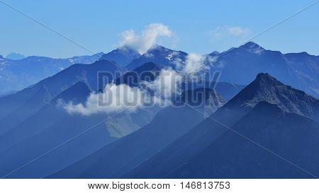 Mountain peaks in the Bernese Oberland. View from Mt Niesen popular travel destination in Switzerland.