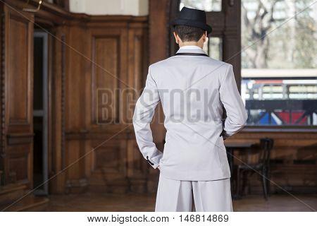 Rear View Of Tango Dancer Standing In Restaurant
