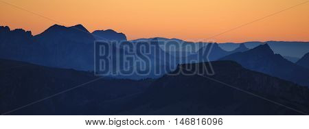 Mountain ranges in Switzerland at sunset. View from Mt Niesen travel destination in the Bernese Oberland.