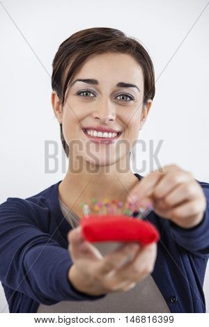 Happy Tailor Holding Pin Cushion