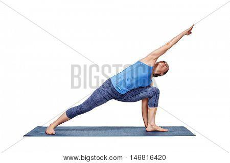 Young fit woman doing Ashtanga Vinyasa Yoga asana Utthita parsvakonasana - extended side angle pose advanced variation isolated on white