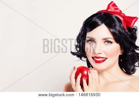 Сarnival Сharacters Makeup. Woman White Snow with red apple