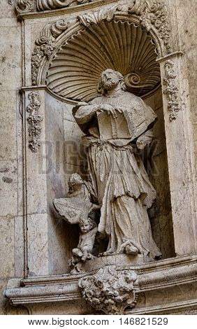 Stone sculpture on the facade of Cathedral in Valencia, Spain