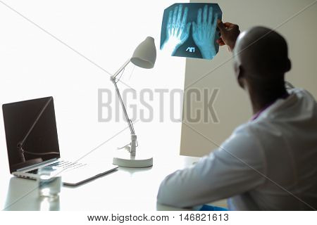 picture of male doctor looking at x-ray
