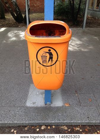 orange trash or garbage can or rubbish bin in Germany
