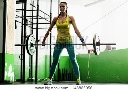 Young fit woman pulling up weight. Too strong.