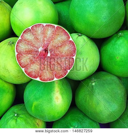 Fresh Red Grapefruit Slice On Grapefruit organic cut background