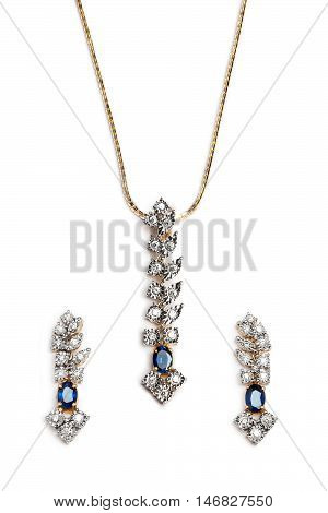 Close up of beautiful Sapphire Diamond necklace with earrings isolated on white background.