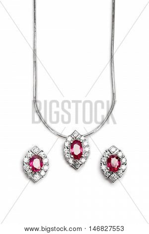 Close up of beautiful Ruby Diamond necklace with earrings isolated on white background.