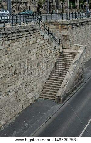 Stone stairway next to road in Budapest