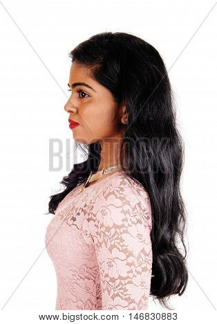 A portrait image of a beautiful Indian woman with long black hair standing in profile isolated for white background.