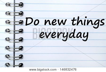 Text Do new things everyday on notepad