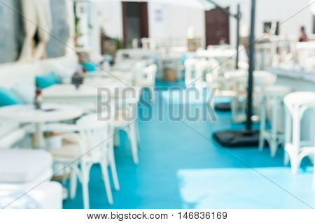 Abstract blurred background of a cafe in the sun