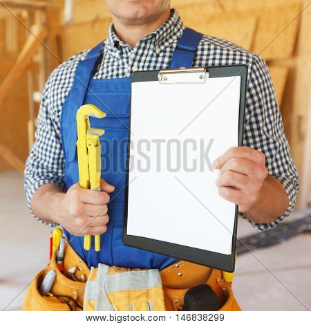 Workman with adjustable wrench and folder with blank document