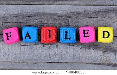 Failed word on grey wooden table closeup