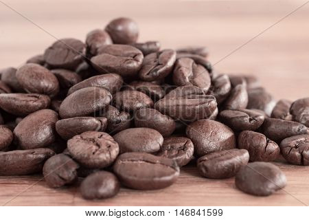 Closeup shot of dark brown roasted coffee beans from colombia