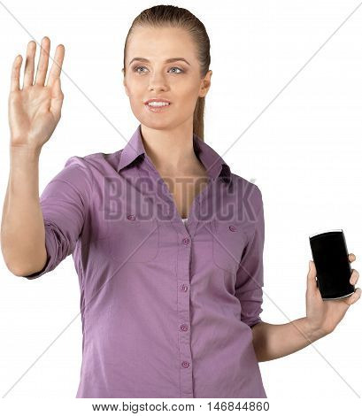 Female holding a handheld device in one hand and holding her other hand up in front of her face - isolated image
