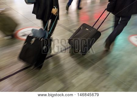 Motion Blur Photo of People Carrying Their Luggage