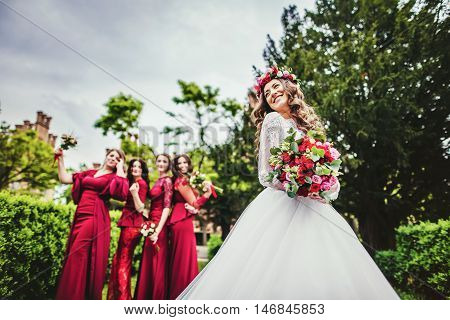 Bride With Bridesmaids In A Park