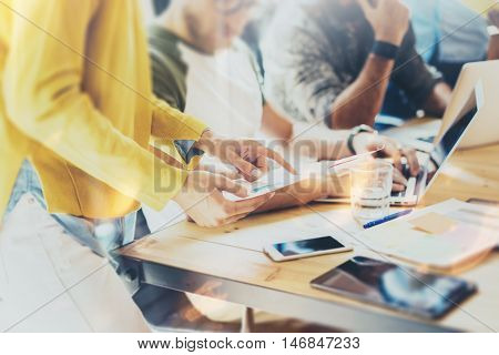 Woman Coworker Making Great Business Decisions.Young Marketing Team Discussion Corporate Work Concept Office.Startup Creative Idea Presentation Tablet.Hipsters Working Wood Table Paper Plans.Blurred