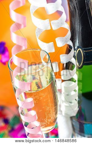 Champagne Bottle and Glass with Balloons and Streamers