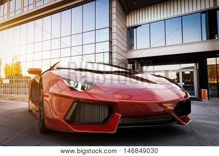Red fast sports car in modern urban setting. Generic, brandless design. 3D rendering