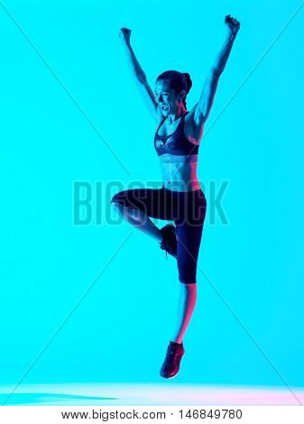 woman fitness exercices jumping isolated