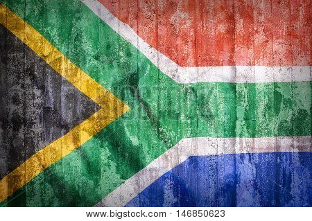 Grunge Style Of South Africa Flag On A Brick Wall
