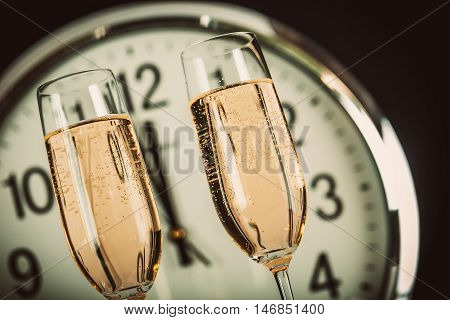 Champagne Glasses with Clock Close to Midnight