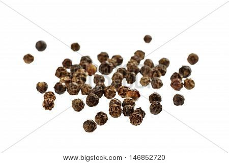 Black peppercorns spices isolated on white background.