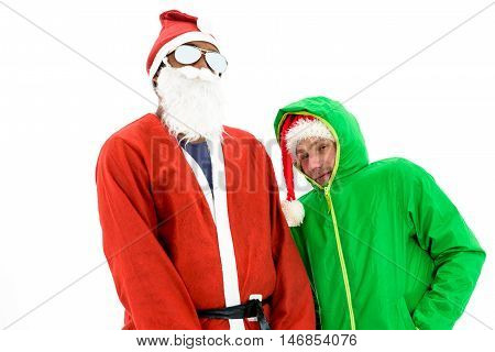 African American Black Thug Gangster Santa and green elf. Santa Claus in red costume suit. Santa's little helper in green jacket.