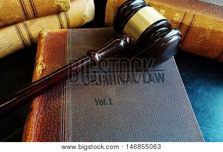 Old Criminal Law books with court gavel