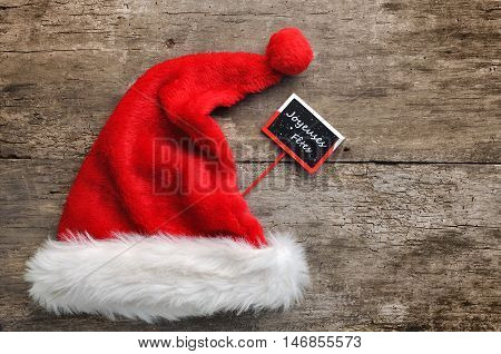 santa fur cap with a little panel writting Happy holidays in french