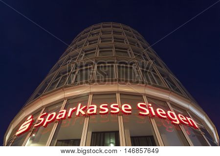 SIEGEN GERMANY - SEP 1 2016: The Sparkasse Siegen bank tower in the city of Siegen illuminnated at night. North Rhine Westphalia Germany
