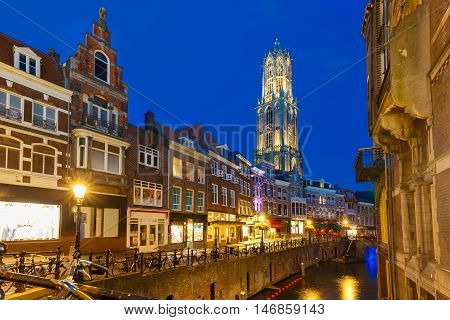 Dom Tower, bridge and canal Oudegracht in the night colorful illuminations in the blue hour, Utrecht, Netherlands