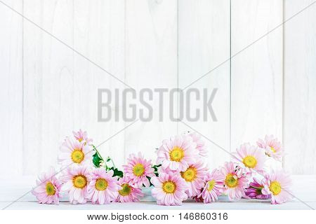 daisy flowers on the white wooden background.