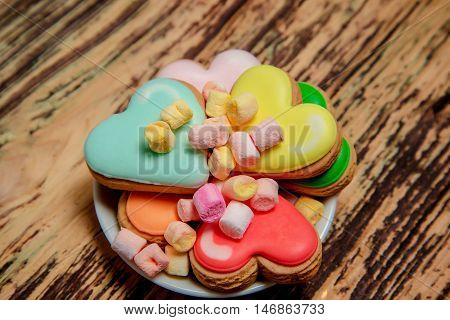 Colorful Biscuits And Sweets On Wood