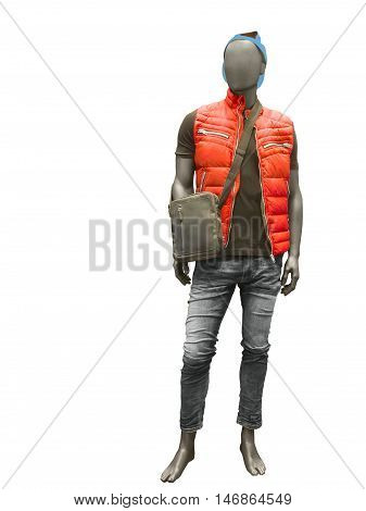 Full length male mannequin dressed in red vest and jeans isolated on white background. No brand names or copyright objects.