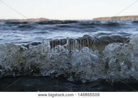 The lake and a wave. The wave is like a tsunami.