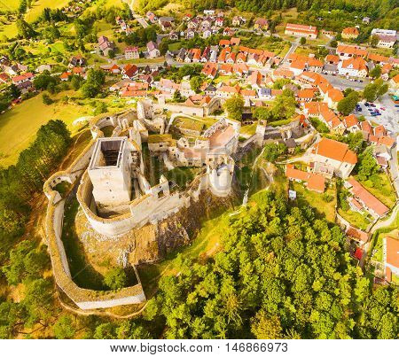 Aerial view of ancient ruins (gothic castle Rabi) and medieval town Rabi in Southwest Bohemia. A discovery landmarks from drone. Czech Republic, Europe.