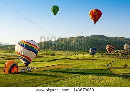 Hot air balloons fly over Cappadocia is known around the world as one of the best places to fly with hot air balloons Goreme Cappadocia Turkey.