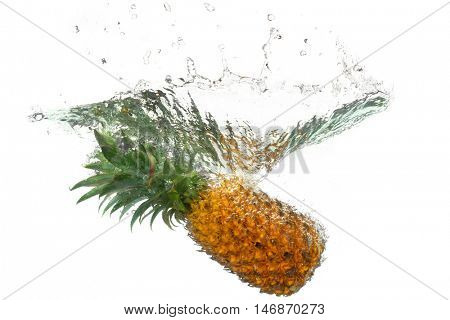 Pineapple splashes into the water