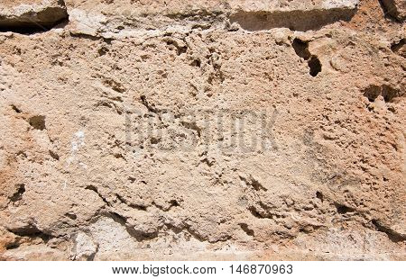 Stone Wall Background In Honey Color