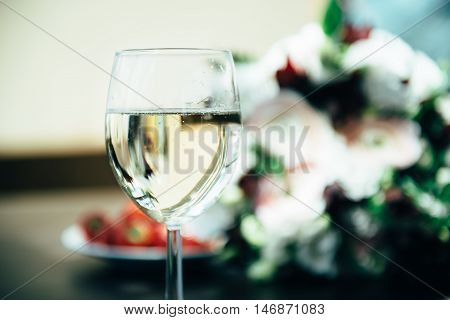 Prenuptial romantic morning. On the table there is glass with champagne
