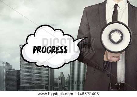 Progress text on speech bubble with businessman holding megaphone